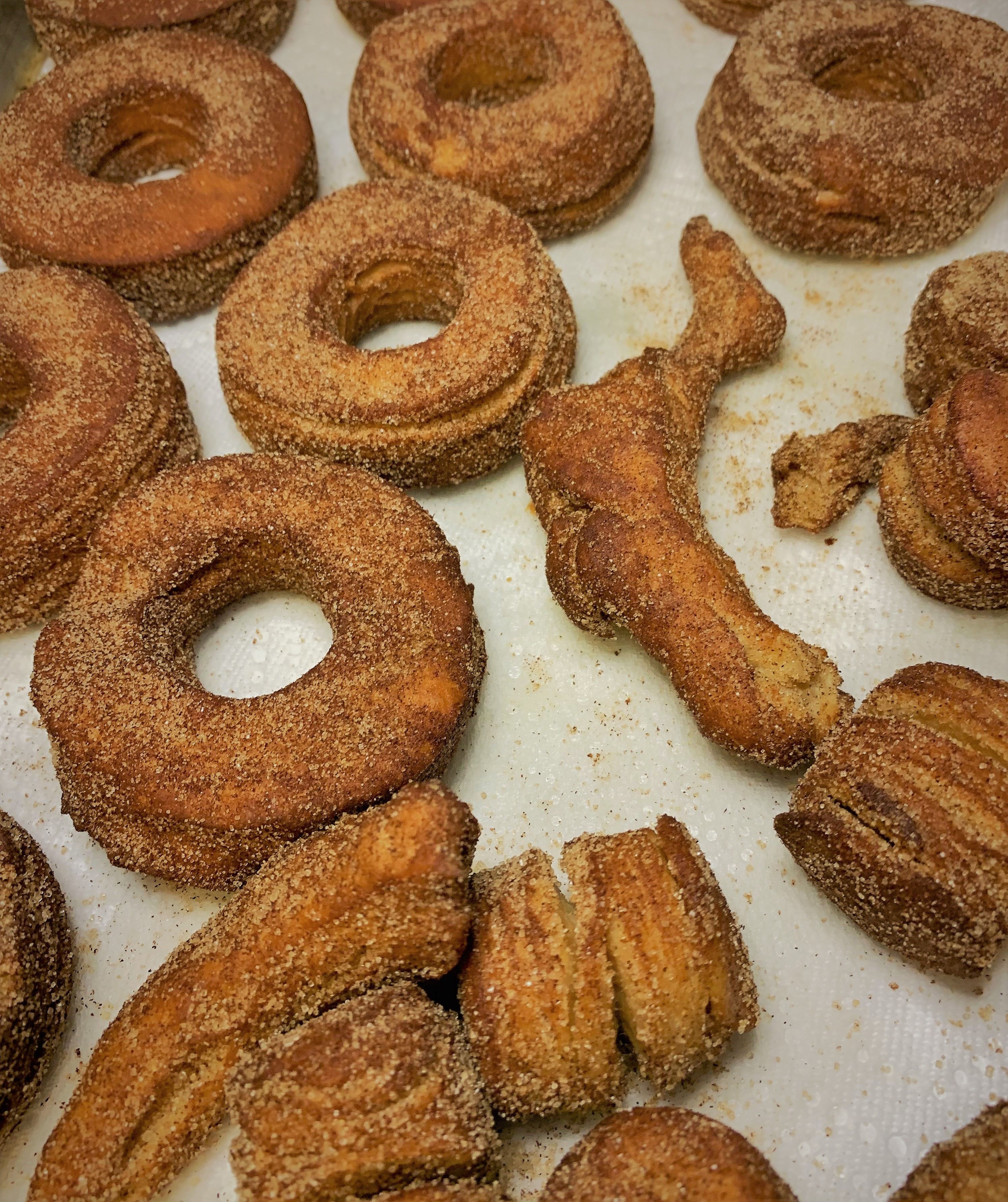 Our cooked and coated Croissant Doughnuts